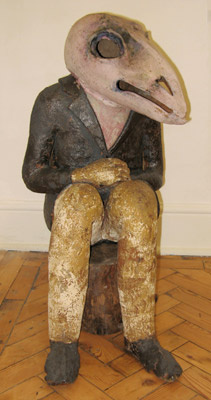After Lorca,seated figure ceramic sculpture by Meri Wells